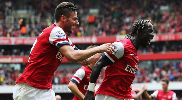 LONDON, ENGLAND - SEPTEMBER 22: Bacary Sagna of Arsenal (R) celebrates with Olivier Giroud as he scores their third goal during the Barclays Premier League match between Arsenal and Stoke City at Emirates Stadium on September 22, 2013 in London, England. (Photo by Ian Walton/Getty Images)