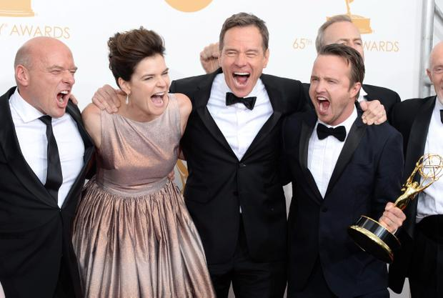 LOS ANGELES, CA - SEPTEMBER 22: (L-R) Actors Dean Norris, Betsy Brandt, Bryan Cranston and Aaron Paul, winners of Outstanding Drama Series for