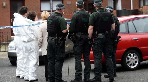 Police at the scene after shots were fired through a kitchen window of a house at Eliza Street Terrace in the Markets area in south Belfast. Pic Colm Lenaghan/Pacemaker