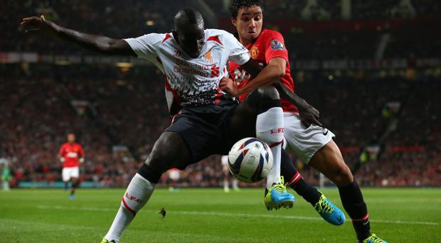 Rafael of Manchester United competes with Mamadou Sakho of Liverpool during the Capital One Cup Third Round match betwen Manchester United and Liverpool at Old Trafford on September 25, 2013 in Manchester, England. (Photo by Julian Finney/Getty Images)