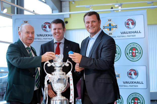 Edwin Ferris (NISFA Competitions convenor), Ian Duncan (Sales manager - Charles Hurst Vauxhall, Belfast) and Jim Magilton (Irish FA Elite Performance director) at the draw