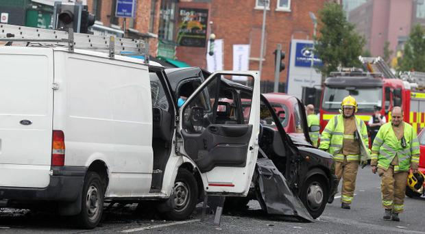 Ten people injured - three of whom are in a serious condition - in a multi-car crash in west Belfast. Emergency services pictured at the scene on the Falls Road at the junction of Beechmount Avenue.