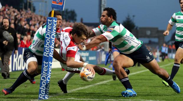Ulster's Michael Allen tackled to touch just before scoring by Manoa Vosawai and Edoardo Gori of Benetton Treviso. Rabo Pro12 Ulster v Benetton Treviso at Ravenhill, Belfast. INPHO/Dan Sheridan