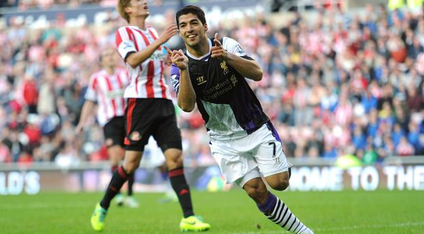 Liverpool's Luis Suarez celebrates scoring his side's third goal during the Barclays Premier League match at the Stadium of Light, Sunderland.