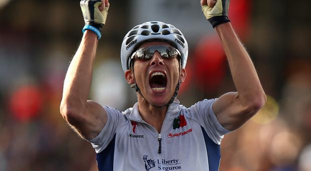 Rui Costa of Portugal celebrates crossing the finish line to win the Elite Men's Road Race, a 272km race from Lucca to Florence on September 29, 2013 in Florence, Italy. (Photo by Bryn Lennon/Getty Images)