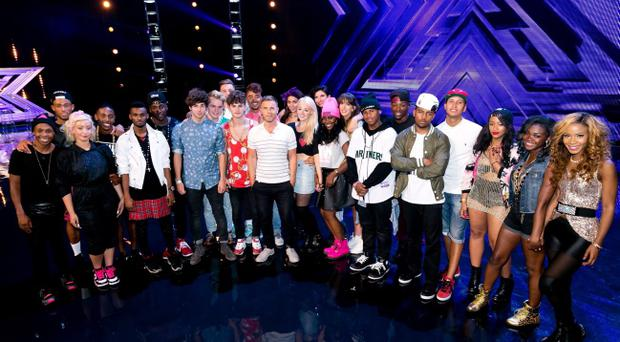 Gary Barlow with contestants during the Boot Camp stage of the ITV1 talent show, The X Factor. Tom Dymond/ITV/PA Wire