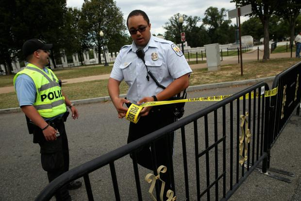 WASHINGTON, DC - OCTOBER 01: U.S. Park Police set up barricades around the World War II Memorial to prevent people from entering the monument on the National Mall October 1, 2013 in Washington, DC. National Park Service park facilities and grounds were closed and more than 21,000 of the service's employees were furloughed after Congress was unable to agree on a federal budget and shut down for the first time in 17 years. (Photo by Chip Somodevilla/Getty Images)