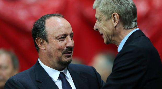 Napoli manager Rafael Benitez (left) greets Arsenal manager Arsene Wenger (right) before kick off during the UEFA Champions League match at the Emirates Stadium