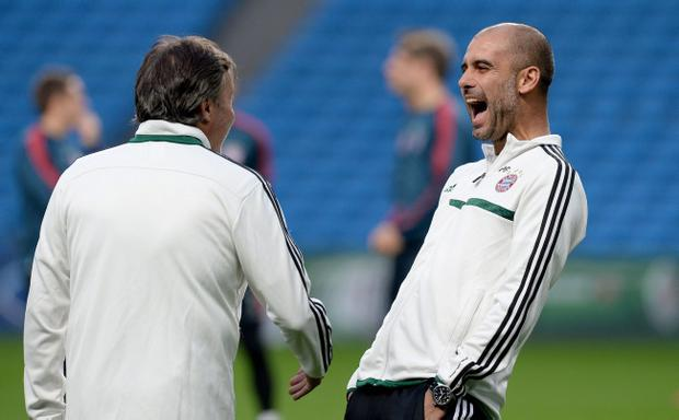 Bayern Munich manager Pep Guardiola shares a joke with his coaching staff during a training session at the Etihad Stadium, Manchester, Tuesday October 1, 2013