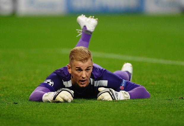 MANCHESTER, ENGLAND - OCTOBER 02: Joe Hart of Manchester City shows his disappointment during the UEFA Champions League Group D match between Manchester City and FC Bayern Munchen at Etihad Stadium on October 2, 2013 in Manchester, England. (Photo by Laurence Griffiths/Getty Images)