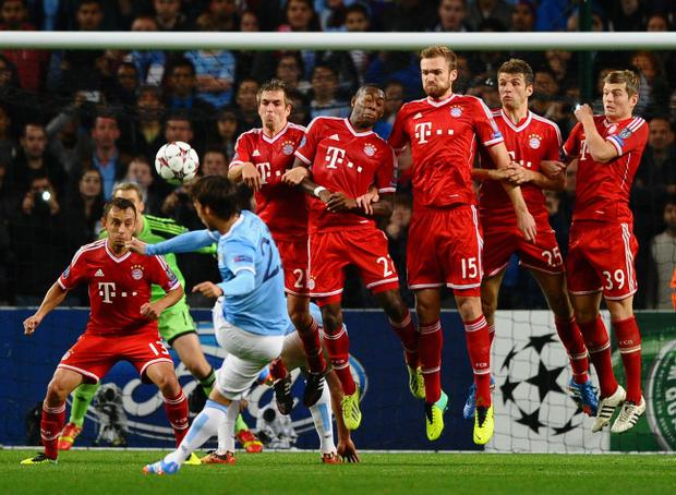 MANCHESTER, ENGLAND - OCTOBER 02: David Silva of Manchester City hits a free kick during the UEFA Champions League Group D match between Manchester City and FC Bayern Muenchen at Etihad Stadium on October 2, 2013 in Manchester, England. (Photo by Laurence Griffiths/Getty Images)