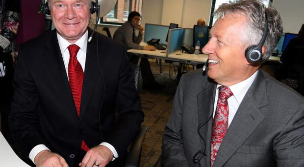 Deputy First Minister Martin McGuinness (left) and First minister Peter Robinson visiting Stream Global Services in east Belfast