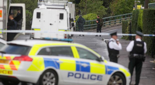 Police and army personal pictured at the scene of the security alert on Finaghy Road North in south Belfast. Pic Jonathan Porter
