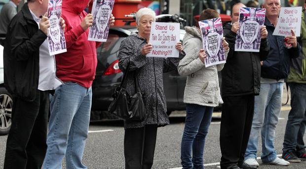 A loyalist white line protest outside the Parades Commission's offices on Bedford Street in Belfast city centre