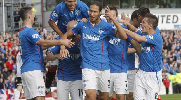 Rangers' Belil Mohsni celebrates his goal with team mates during the Scottish League One match at Somerset Park, Ayr.