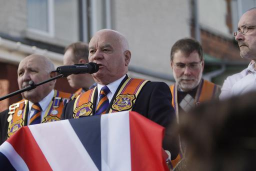 Leading Orangeman William Mawhinney, County Grand Secretary of Belfast District, addresses loyalist protesters at Woodvale.
