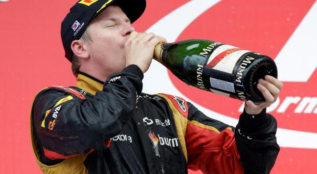 Lotus driver Kimi Raikkonen of Finland drinks champagne as he celebrates his second place finish in the Korean Formula One Grand Prix at the Korean International Circuit in Yeongam, South Korea, Sunday, Oct. 6, 2013. (AP Photo/Lee Jin-man)