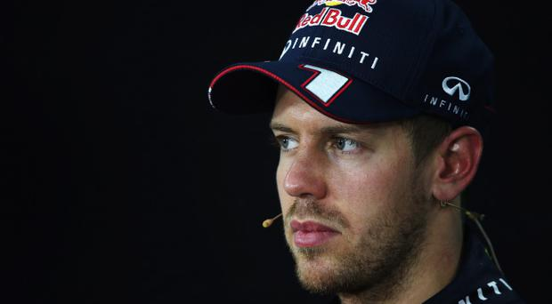 YEONGAM-GUN, SOUTH KOREA - OCTOBER 06: Sebastian Vettel of Germany and Infiniti Red Bull Racing attends the post race press conference after winning the Korean Formula One Grand Prix at Korea International Circuit on October 6, 2013 in Yeongam-gun, South Korea. (Photo by Mark Thompson/Getty Images)
