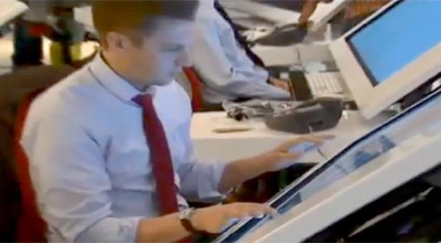 A Fox News information specialist at work on his 'big area touch screen'