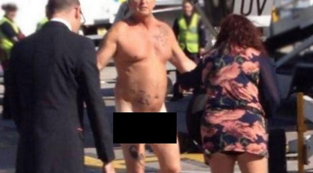A man was tasered by police after stripping naked and confronting staff on the runway of Manchester Airport. Source: Manchester Evening News