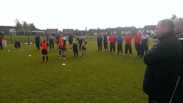 Coaching staff at Lenadoon Park put players through their paces
