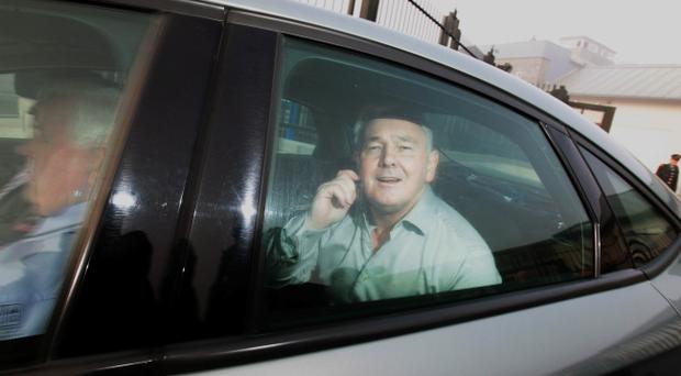 Drug baron John Gilligan is driven away after he walked free from Portlaoise prison