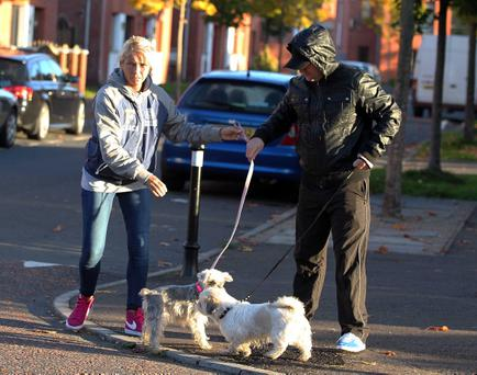An actor pictured with Kevin Kearney's partner Charlene and the family dogs pictured during the reconstruction