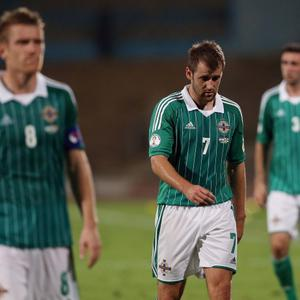 Northern Ireland's Niall McGinn after Israel's Eden Ben Basat scores during Tuesday night's 2014 World Cup Qualifier at the Ramat Gan stadium in Tel Aviv.