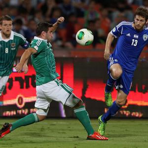 Israel's Sheran Yeini with Northern Ireland's Martin Paterson during Tuesday nights 2014 World Cup Qualifier at the Ramat Gan stadium in Tel Aviv.