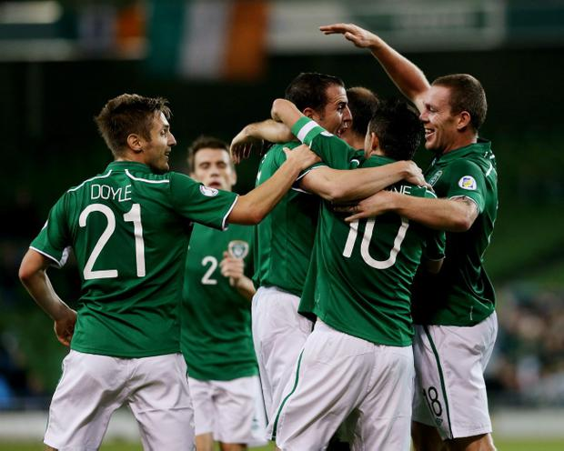 Republic of Ireland's John O'Shea (third left) celebrates with team-mates after scoring his side's second goal during the FIFA 2014 World Cup Qualifying, Group C match at the Aviva Stadium, Dublin.