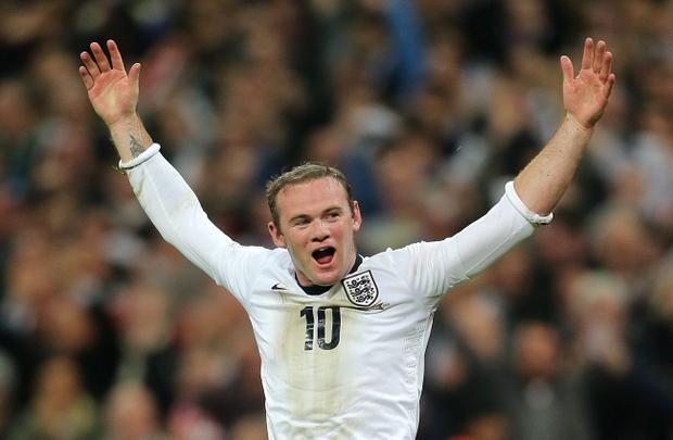 England's Wayne Rooney celebrates scoring his side's first goal of the game during the FIFA 2014 World Cup Qualifying, Group H match at Wembley Stadium, London.
