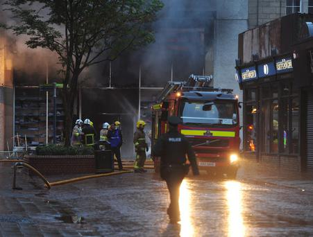 Around 40 firefighters deal with a blaze at B&M Bargains shop in Rosemary Street in Belfast city centre, after being called by police who noticed the fire on Friday morning