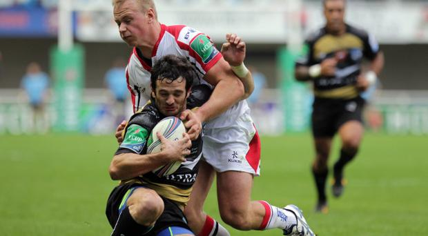 Ulster's Luke Marshall in action with Montpellier's Yoan Audrin