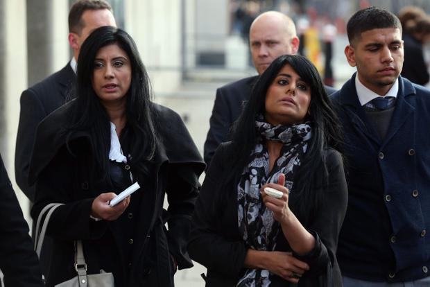 Relatives of Mohammed Saleem, who was murdered whilst walking home from a Birmingham mosque, address the media outside the Old Bailey on October 21, 2013 in London, England