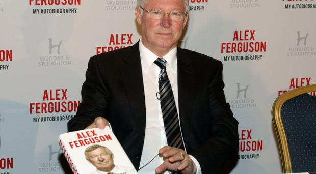 Sir Alex Ferguson with his Autobiography during the photocall at the Institute of Directors, London.