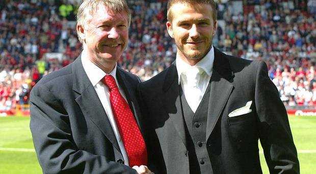 File photo dated 04/11/2011 of Manchester United's David Beckham (right). Ferguson says Beckham's football was affected by his celebrity lifestyle