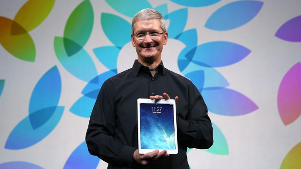 Apple CEO Tim Cook holds the new iPad Air during an Apple announcement at the Yerba Buena Center for the Arts on October 22, 2013 in San Francisco, California