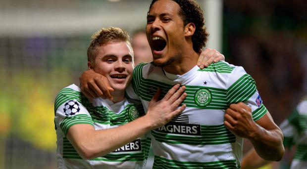James Forrest (L) of Celtic is congratulated by teammate Virgil van Dijk of Celtic after scoring the opening goal from the penalty spot during the UEFA Champions League Group H match between Celtic and Ajax at Celtic Park