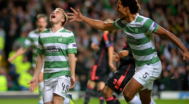GLASGOW, SCOTLAND - OCTOBER 22: James Forrest (L) of Celtic is congratulated by teammate Virgil van Dijk of Celtic after scoring the opening goal from the penalty spot during the UEFA Champions League Group H match between Celtic and Ajax at Celtic Park Stadium on October 22, 2013 in Glasgow, Scotland. (Photo by Jeff J Mitchell/Getty Images)