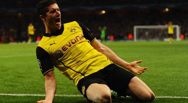 LONDON, ENGLAND - OCTOBER 22: Robert Lewandowski of Borussia Dortmund celebrates scoring their second goal during the UEFA Champions League Group F match between Arsenal and Borussia Dortmund at Emirates Stadium on October 22, 2013 in London, England. (Photo by Mike Hewitt/Bongarts/Getty Images)