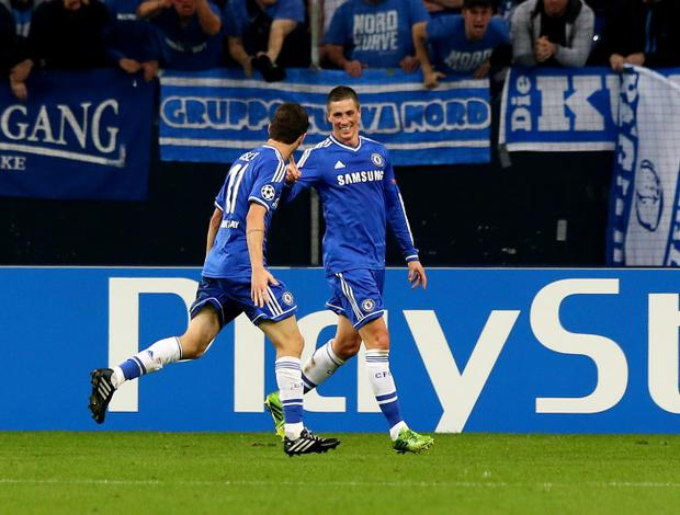 GELSENKIRCHEN, GERMANY - OCTOBER 22: Fernando Torres of Chelsea (R) celebrates with team mate Oscar (L) as he scores their second goal during the UEFA Champions League Group E match between FC Schalke 04 and Chelsea at Veltins-Arena on October 22, 2013 in Gelsenkirchen, Germany. (Photo by Martin Rose/Bongarts/Getty Images)