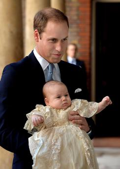 The Duke of Cambridge arrives, holding his son Prince George, at Chapel Royal in St James's Palace, ahead of the christening of the three month-old Prince George of Cambridge by the Archbishop of Canterbury in central London