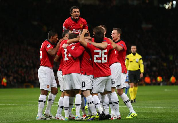 Wayne Rooney of Manchester United celebrates with his team-mates after Inigo Martinez of Real Sociedad scored an own goal to make the score 1-0 during the UEFA Champions League Group A match between Manchester United and Real Sociedad at Old Trafford