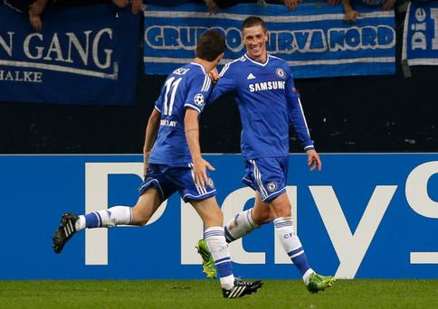 Chelsea's Fernando Torres, right, celebrates with teammate Oscar after scoring his second goal during the Champions League group E soccer match between FC Schalke 04 and Chelsea FC in Gelsenkirchen, Germany, Tuesday, Oct. 22, 2013. Torres scored the opening goal. (AP Photo/Frank Augstein)