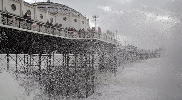 Waves crash near Brighton Pier in East Sussex, as England and Wales face a battering tonight from the worst storm in five years, forecasters warn.