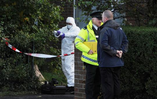 Police forensics at the scene after a woman died in a fire at a garage in Oakleigh Park in Portadown Pic Colm Lenaghan/Pacemaker