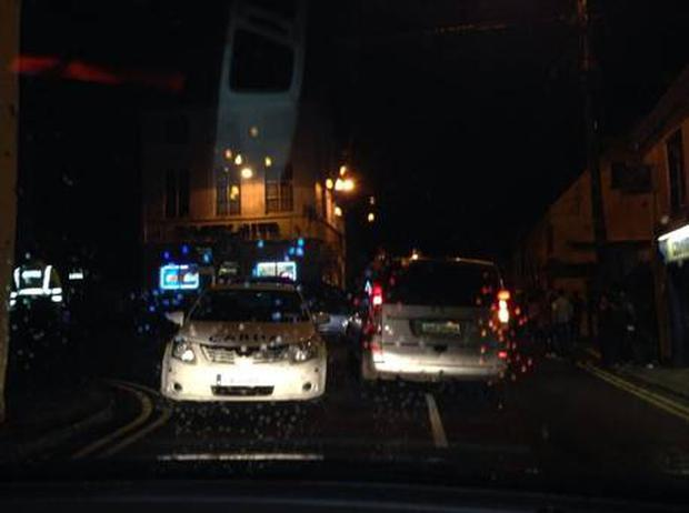 A Twitter user posted this photo of Gardai in Cloyne village on Saturday night. (Twitter)