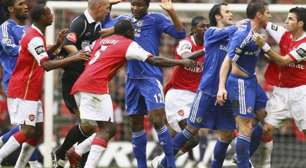 Arsenal and Chelsea players clash during the infamous 'Snarling' Cup final of 2007