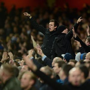 LONDON, ENGLAND - OCTOBER 29: Chelsea fans gesture in the crowd during the Capital One Cup Fourth Round match between Arsenal and Chelsea at the Emirates Stadium on October 29, 2013 in London, England. (Photo by Jamie McDonald/Getty Images)