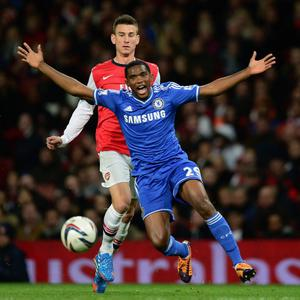 LONDON, ENGLAND - OCTOBER 29: Samuel Eto'o of Chelsea reacts after missing an opportunity as Laurent Koscielny of Arsenal looks on during the Capital One Cup Fourth Round match between Arsenal and Chelsea at the Emirates Stadium on October 29, 2013 in London, England. (Photo by Jamie McDonald/Getty Images)